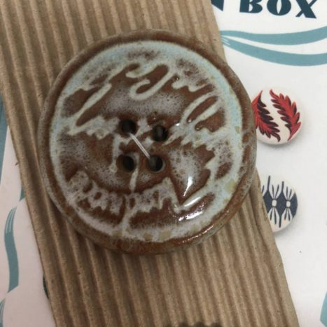 Ceramic Buttons Large Round Brown with Script L364